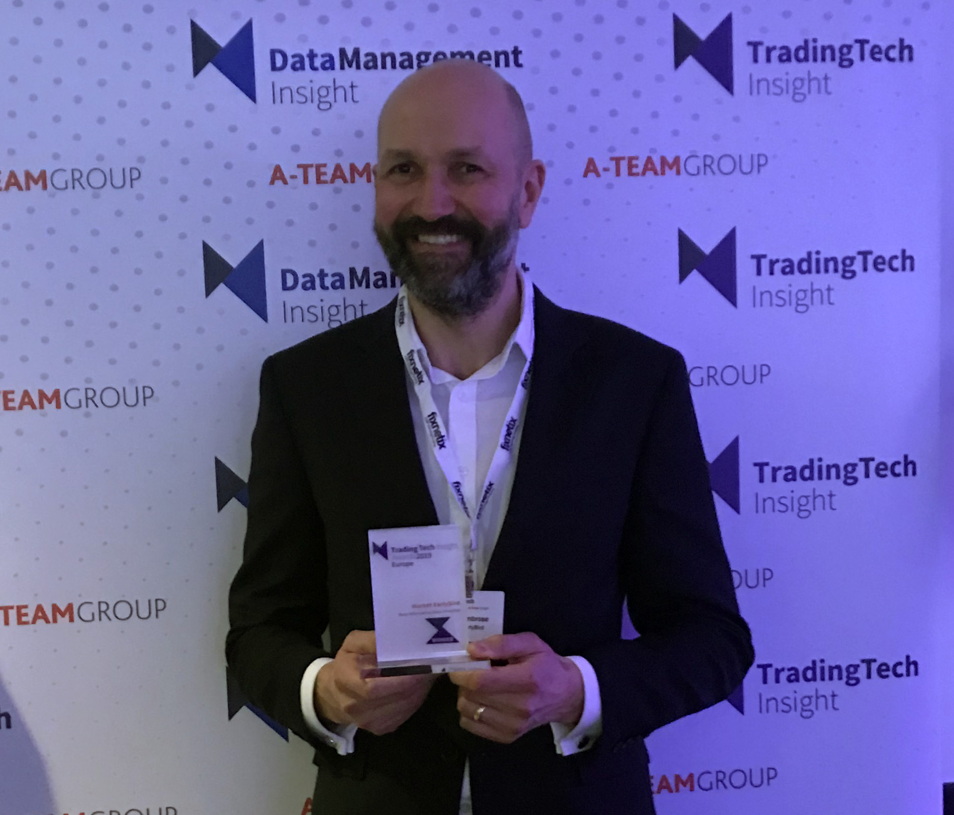 Danny Ambrose holding the TradingTech Insight Europe 2019 Award for Best Data Provider